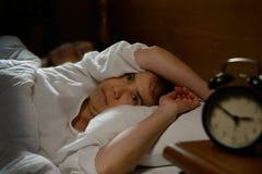 妇女以失眠 图库摄影