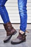 妇女靴子和牛仔裤 免版税库存照片