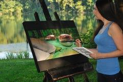 妇女绘画自然场面 库存图片
