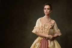 妇女画象历史礼服的 免版税库存照片