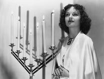 妇女画象有大烛台的 图库摄影
