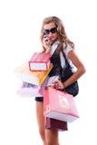 妇女年轻人的接近的愉快的疯狂购物 免版税库存照片