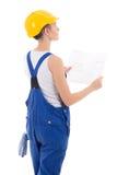 妇女建造者后面看法在蓝色工作服的有大厦schem的 图库摄影