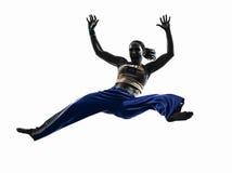 妇女capoeira舞蹈家跳舞剪影 图库摄影