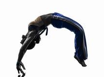 妇女capoeira backflip舞蹈家跳舞剪影 免版税库存照片