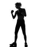 妇女kickboxing的姿势拳击手拳击 库存图片