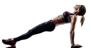 妇女pilates健身行使被隔绝的剪影 库存图片