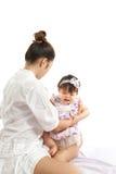 妈妈是举行和使用与她的婴孩 图库摄影