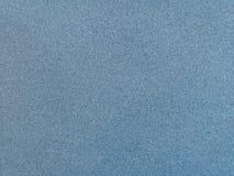 委员会和老纸纹理蓝色背景 库存照片