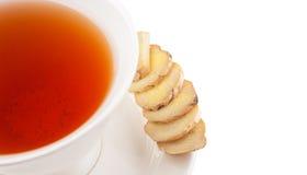 姜根切片和一杯茶III 免版税库存图片