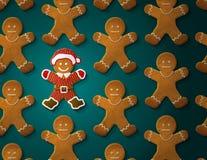 姜饼人在圣诞节衣服装饰 免版税库存图片