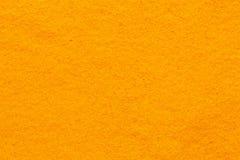 姜黄姜黄香料粉末充分的框架光滑的表面 免版税库存图片