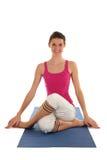 姿势供以座位的女子瑜伽 免版税库存图片