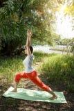 姿势女子瑜伽 库存照片