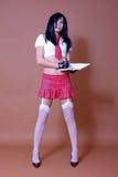 姿势女小学生性感的身分 库存照片