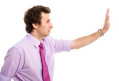姿态做的男性符号终止年轻人 免版税库存照片