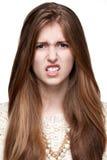 姿态 憎恶 关闭女孩的画象 免版税库存照片
