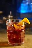 威士忌酒用桔子和冰 库存照片