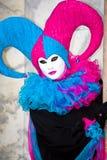 威尼斯式蓝色服装的粉红色 免版税库存图片
