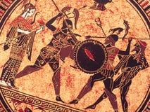 威尼斯,意大利- 2017年7月02日:从老历史希腊油漆的细节在盘 神话战斗对此的英雄和神 免版税库存图片