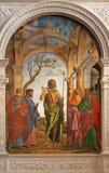 威尼斯-圣约翰浸礼会教友和圣徒Cima da科内利亚诺(1495)在教会圣玛丽亚小山谷Orto 免版税库存图片