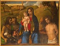 威尼斯-玛丹娜和圣徒Bellini (乔安妮斯Bellinus 1430 – 1437)在教会圣弗朗切斯科della豇豆 库存照片