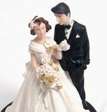 婚姻蛋糕的玩偶 免版税库存照片
