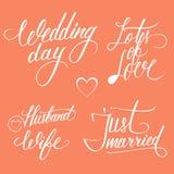婚礼之日在红色背景的印刷术元素 库存照片