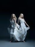 婚礼礼服的舞女与multiexposition 免版税库存照片