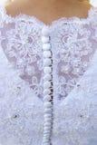 婚礼礼服细节和新娘 免版税库存图片
