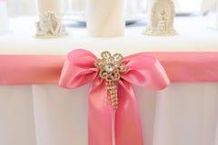 """婚礼细节†""""桃红色丝带弓 免版税库存图片"""