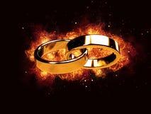 婚姻婚姻与圆环圆环婚戒火热火焰的烧伤结婚 图库摄影
