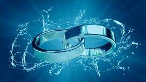婚姻婚姻与圆环圆环婚戒结婚在水飞溅下 免版税库存图片