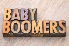 婴儿潮出生者在木类型的词摘要 库存照片