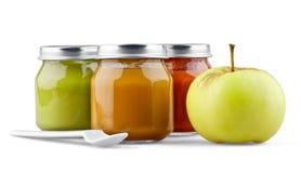 婴儿食品、苹果和匙子 免版税库存图片