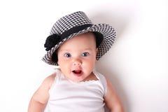 婴孩使面孔,儿童在白色的` s画象惊奇 库存照片