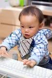婴孩关键董事会个人计算机作用 库存照片