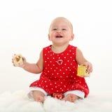 婴孩叮咬毯子女孩嘴唇鹳上面的白色 免版税库存照片