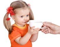 婴孩吃女孩桔子梨 库存照片