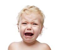 婴孩哭泣的女孩查出 免版税库存图片