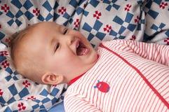 婴孩嘻嘻笑甜点 库存照片