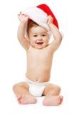 婴孩圣诞节帽子红色圣诞老人 免版税库存照片