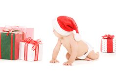 婴孩圣诞节礼品辅助工圣诞老人 免版税图库摄影