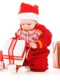 婴孩圣诞节礼品辅助工圣诞老人 免版税库存照片