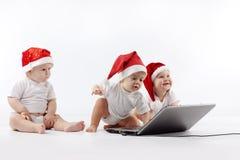 婴孩圣诞节膝上型计算机 库存图片