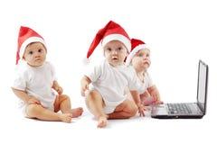 婴孩圣诞节膝上型计算机 库存照片