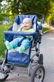 婴孩坐的婴儿推车 图库摄影