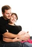 婴孩夫妇愉快的等待的年轻人 免版税库存照片