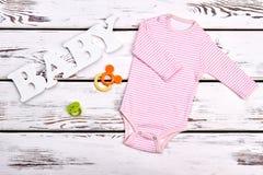 婴孩女孩桃红色条纹紧身衣裤 免版税库存照片