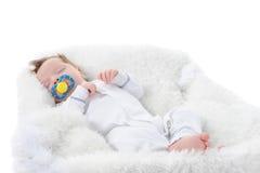 婴孩她的嘴安慰者休眠 库存图片